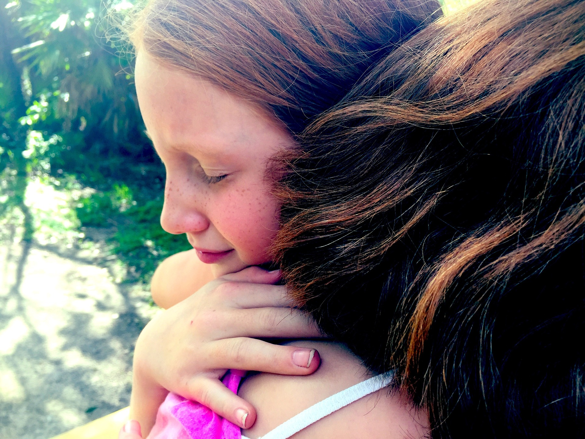 Girls hugging emotionally