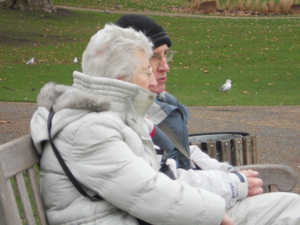 elderly couple on park bench