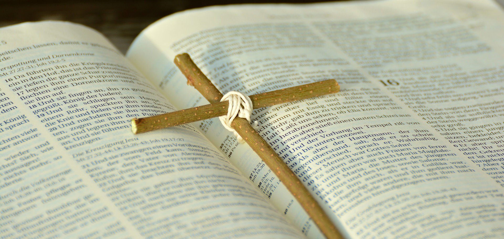 handmade cross on Bible