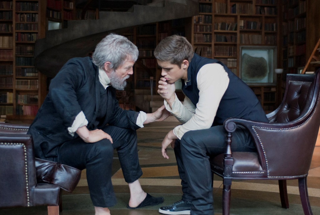 Scene from The Giver, man and boy talking