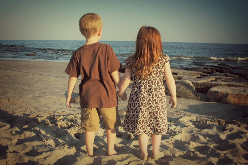 """Children on beach Red hair, blonde hair, brown hair, black hair - All from our genes - Genes, the Oldest """"Writing"""" in the World"""