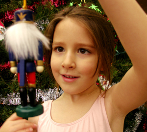 Girl with nutcracker - Looking for Symbols of Christmas While You Shop