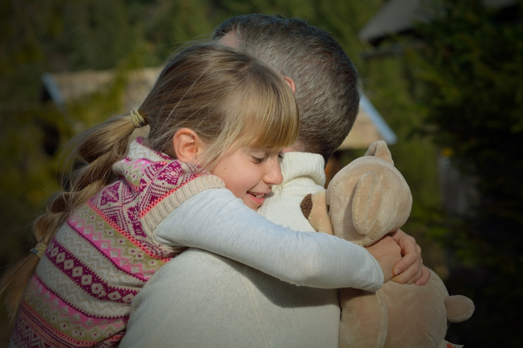 Girl hugging man