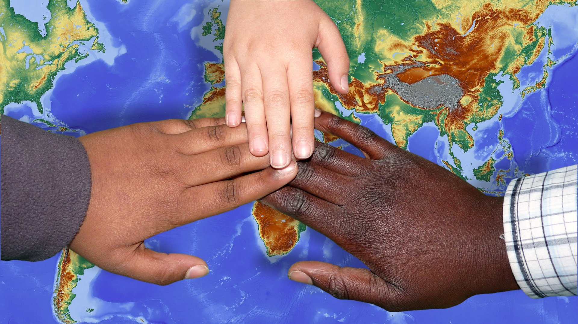 children's hands - different colors, one race