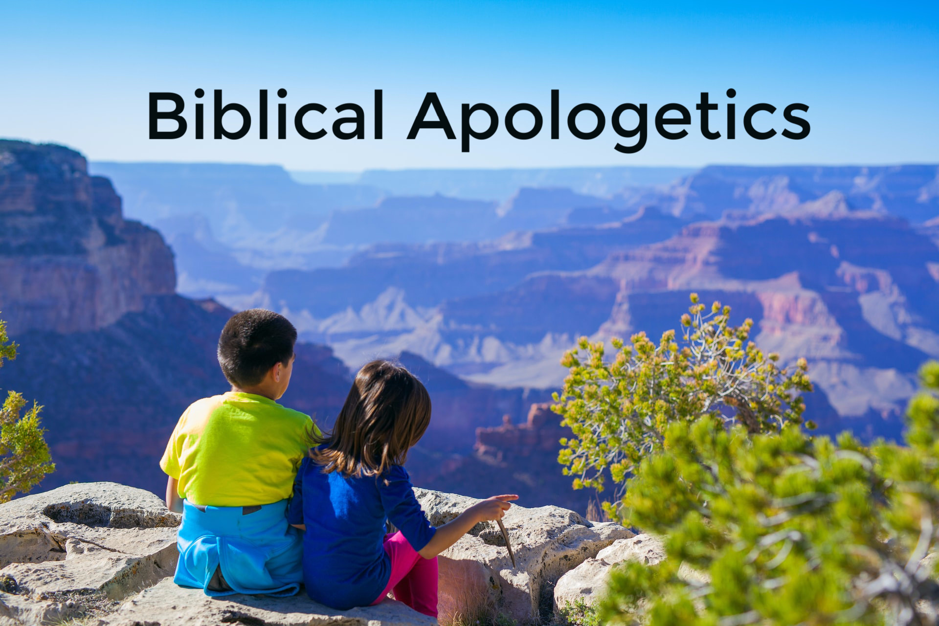 Biblical Apologetics, boy and girl sitting on rim of canyon