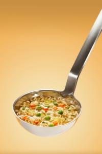 soup ladle with vegetable soup